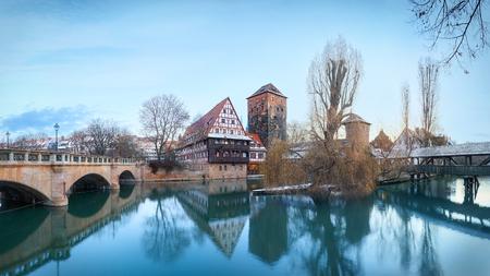 Winter panorama of Henker haus and Henkersteg bridge over Pegnitz river in Nuremberg, Bavaria, Germany Stock Photo