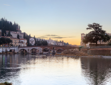 historical quarter of Verona, view from river on ponte Pietra bridge at sunset