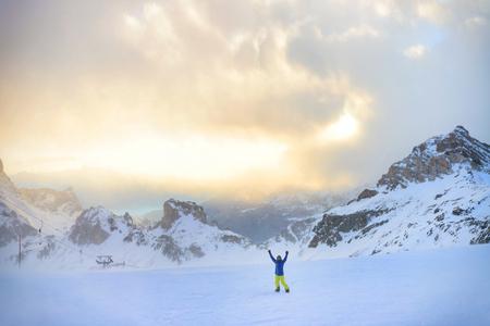 Winter snowboarding activity in high Italian Alps