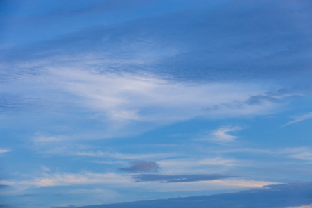 sky background with nice clouds on bright blue sky