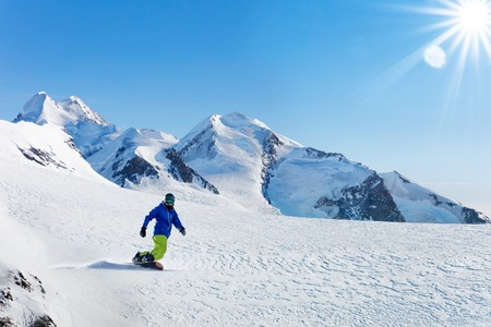 Winter snowboarding activity on sunny day in Alps Stock Photo