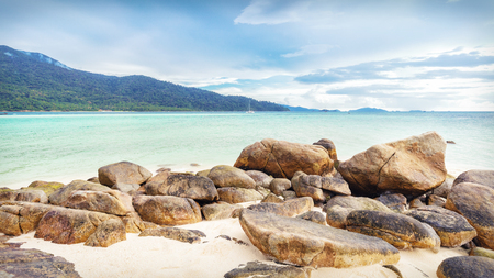 Empty moody Koh Lipe Bulow Beach with rocks on foreground Stock Photo