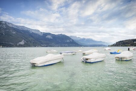 Lake of Annecy. Moody landscape with boats Banco de Imagens