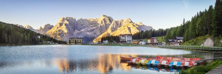 Misurina lake in summer on sunrise with no tourists, Dolomites, Alps, Italy Banco de Imagens