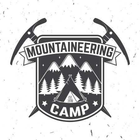 Vintage typography design with ice ax and mountain silhouette.