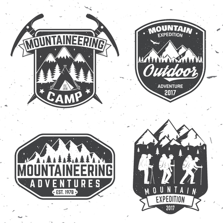 Vintage typography design with mountaineers and mountain silhouette.