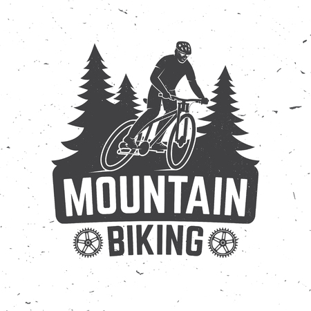 Vintage typography design with man riding bike and forest silhouette.