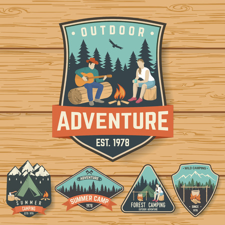 Set of Summer camp badges on the wood board
