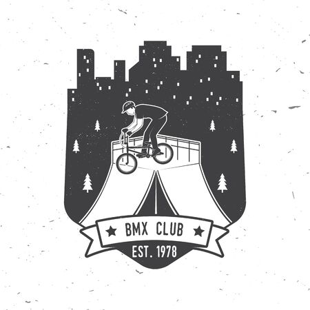 Bmx extreme sport club badge. Vector. Concept for shirt, print, stamp, tee with man ride on a sport bicycle. Vintage typography design with bmx cyclist and night city silhouette.