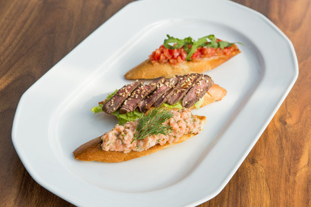 hoagie: Healthy open sandwiches with tomatoes, grilled beef on white plate Stock Photo