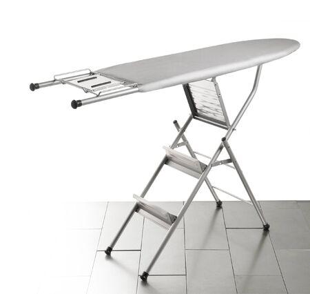 domesticity: Ironing board on white background