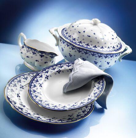 Porcelain dinner set on blue background