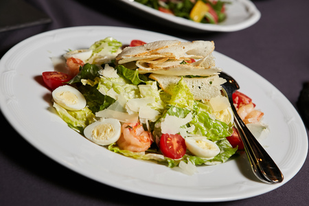 Fresh salad with seafood, and tomatow on white plate Stock Photo