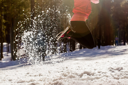 glistening: Legs bouncing girls, snow flies glistening in the sun. Stock Photo