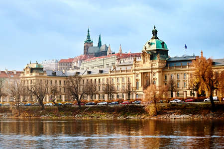 View to the Prague Government Office and Prague Castle from the Vltava river. Famous place in the Czech Republic, ancient Hradcany hill with the president office and Straka academie Stok Fotoğraf