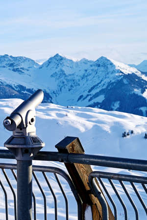 Spyglass aimed at the snowy alpine mountains. Zoom landscape in point of view Stok Fotoğraf