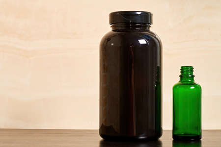 Black and green cosmetic bottles with shampoo and skincare cream. Herbal and natural cosmetics background with copy space for advertisement text