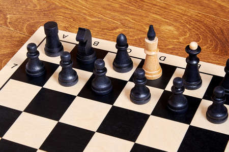 Conceptual representation of a traitor in government based on chess pieces. Symbol of spy and double agent