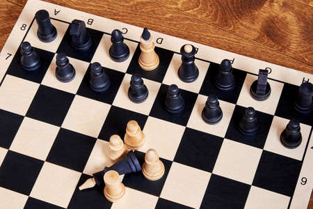 Captivity and exchange concept on the chessboard with chess piece. Sports, symbols and concepts