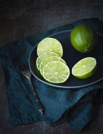 Lime sliced for tea party. Dark photo