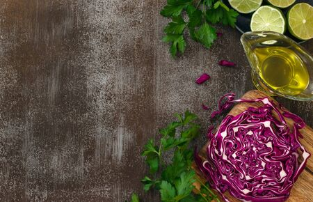 Red cabbage and fresh parsley with a dressing of olive oil and lime juice on wooden table