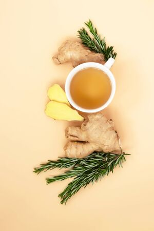 Tea, ginger and rosemary on a light background. Calm, natural colors for relaxation reduce stress, set up for self-care and recovery. Adaptogens improve health and boost the immune system