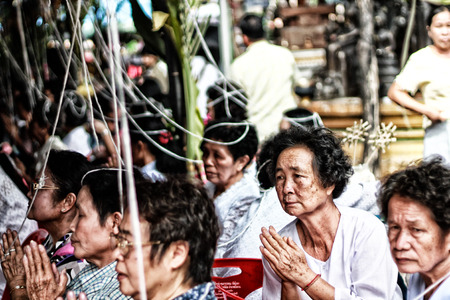 old Asian women of buddhist religion praying