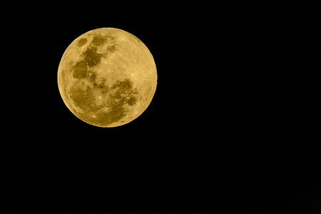 Super full moon, beautiful yellow moon with Black background of 20 February 2019 seen from Bangkok, Thailand.