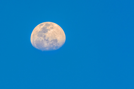 Half moon  with sky blue background in evening seen from Bangkok, Thailand, clipping path. Stockfoto