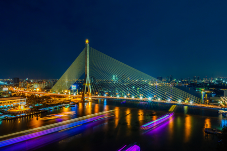 The Rama VIII Bridge, beautiful bridge is crossing the Chao Phraya River with blue sky in night, Bangkok, Thailand. Stok Fotoğraf