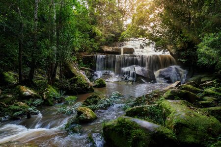 Phonpob waterfall, a beautiful waterfall in a forest filled with green trees at Phu Kradung National Park in the rainy season, which is famous tourist destination in Thailand. Zdjęcie Seryjne