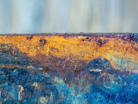 Rusty knives texture with streaks of rust. old sheet of iron covered with rust and corrosion paint.