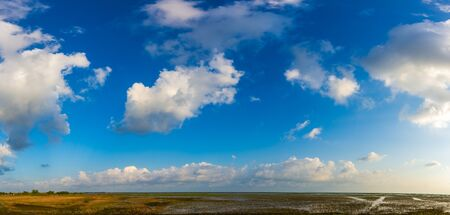 Panorama of a beautiful blue sky filled with white clouds over the big lake at Thale Noi Waterfowl Reserve nonihunting area , the famous for its attractions in Thailand.