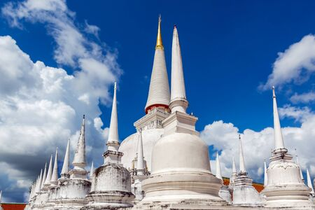Beautiful white pagodas with blue sky and white clouds Standard-Bild
