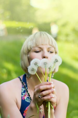 Girl in the nature with dandelions