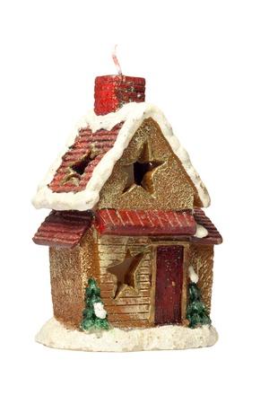 flue season: Vela en forma de una peque�a casa en un fondo blanco