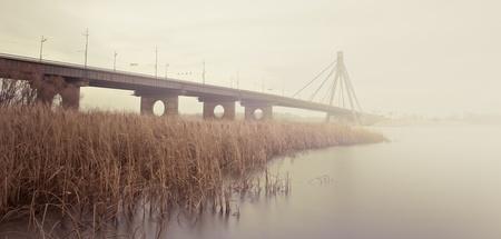 dnepr: Moskovsky Bridge panorama through the river Dnepr in Kiev