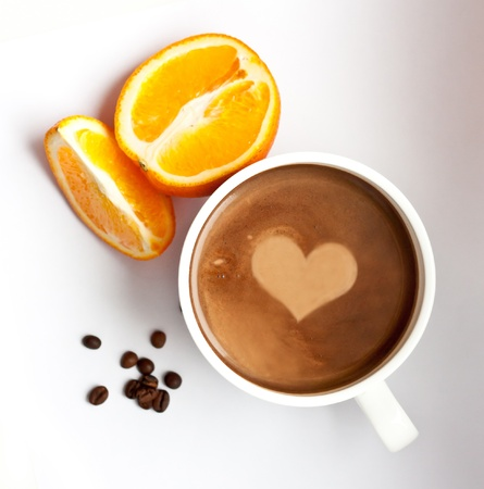 Composition whith a cup of coffee, coffee grains and orange, top look
