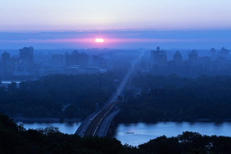A beautiful summer sunrise over the city of Kiev, Ukraine photo