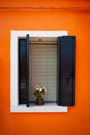 Window one of the colored houses in Burano, Venice, Italy Stock Photo