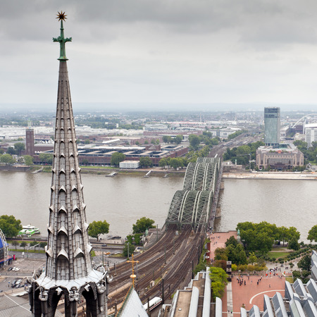View of Cologne, Germany. Gothic cathedral and steel bridge over river Rhine photo
