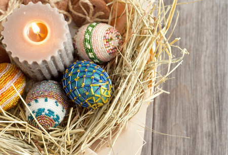 View from the top on Easter eggs, candles and cookies in a basket