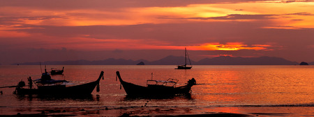 Beautiful colorful sunset and boat in Thailand