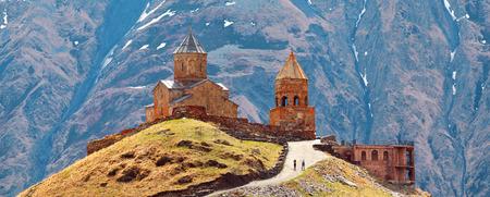 The Beautiful landscape with church near Kazbegi, Georgia, Caucasus. Stock Photo