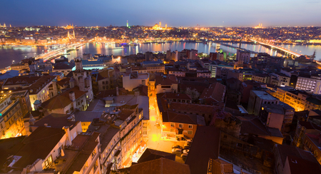 Evening Istanbul. Galata Bridge. Panorama of the evening city from the tower. photo