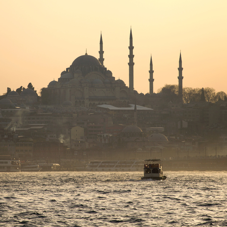 A boat trip on the Bosphorus at sunset. Istanbul at sunset. Evening Istanbul. Tourist trip in Turkey. photo