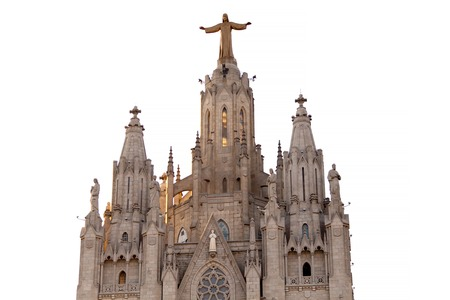 The Sagrat Cor church atop the mountain. Barcelona, Spain. Isolated on white background Statue.