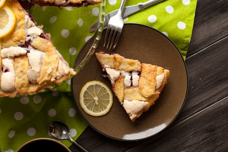 home baking: Homemade pie covered with strawberries and rhubarb and meringue. Home baking in vintage style. Fruit pie. Stock Photo