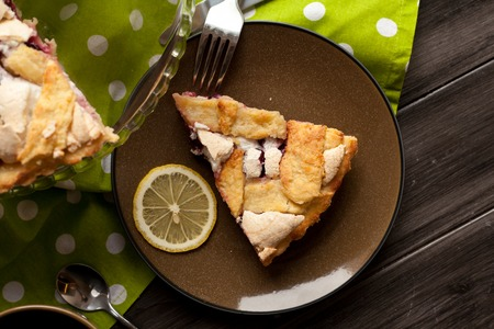 Homemade pie covered with strawberries and rhubarb and meringue. Home baking in vintage style. Fruit pie. Stock Photo