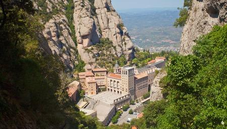 virgin of montserrat: Santa Maria de Montserrat Abbey in Monistrol de Montserrat, Catalonia, Spain. Famous for the Virgin of Montserrat. Benedictine monastery, the spiritual symbol and religious center of Catalonia and a center of pilgrimage for Catholics from around the world